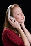 kvinna för 10 hörlurar Fotografering för Bildbyråer