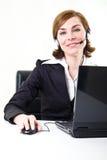 kvinna för affärshörlurar med mikrofonPC Royaltyfria Bilder