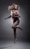 Kvinna för amerikansk fotboll Fotografering för Bildbyråer