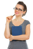kvinna för deltagare för anteckningsbokpenna le Fotografering för Bildbyråer