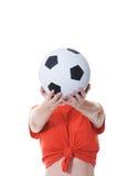 kvinna för fotboll för holding för bollframsidaframdel Arkivfoton