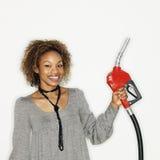 kvinna för gasholdingdysa Arkivbild