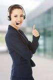 kvinna för hörlurar med mikrofon för felanmälansmitt Royaltyfri Fotografi