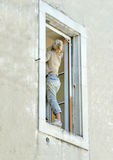 kvinna för husmålning Arkivbilder