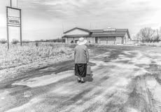 kvinna för isoleringsresväskawhite Arkivbilder