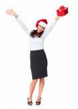 Kvinna för jultomtenhjälpredaaffär med en gåva. Fotografering för Bildbyråer