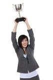 kvinna för koppholdingtrofé fotografering för bildbyråer