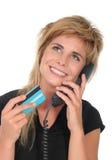 kvinna för kortkrediteringstelefon arkivfoto