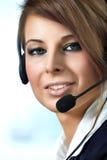 kvinna för tekniker för hörlurar med mikrofon för felanmälansmitt Royaltyfri Fotografi