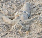 kvinna för träningsoverall för sandskulpturhav Royaltyfria Foton