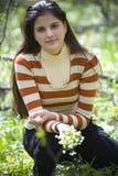 kvinna för gruppblommaholding Fotografering för Bildbyråer