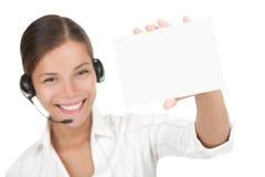 kvinna för hörlurar med mikrofonholdingtecken Arkivfoton