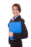 kvinna för stående för affärsclipboardholding Arkivfoto
