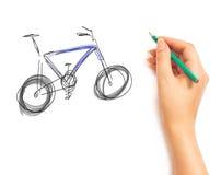 Kvinna hand tecknar en cykel arkivbild