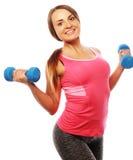 Kvinna i övning för sportutrustning med handvikter Arkivbilder