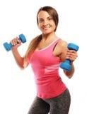 Kvinna i övning för sportutrustning med handvikter Royaltyfria Foton