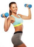 Kvinna i övning för sportutrustning med handvikter Arkivbild