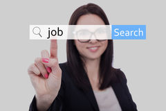 Kvinna i affärsdräkten som söker jobb i internet Royaltyfria Foton