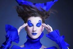 Kvinna i blått Royaltyfria Bilder