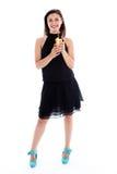 Kvinna i deltagareklänning med en coctail Arkivfoton
