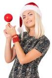 Kvinna i den Santa Claus hatten royaltyfria bilder