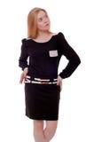 Kvinna i den svarta klänningen som isoleras på vit Royaltyfri Foto
