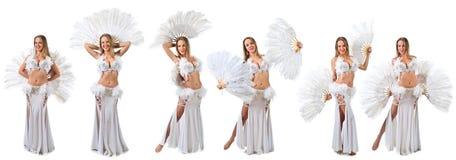 Kvinna i den vita magdansösdräkten Royaltyfri Foto