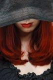 Kvinna i en hatt Arkivfoto