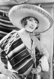 Kvinna i en mexicansk hatt och dräkt (alla visade personer inte är längre uppehälle, och inget gods finns Leverantörgarantier som arkivbild