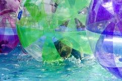 Kvinna i en plast- orb på vatten royaltyfri foto