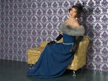 Kvinna i en stol Royaltyfria Foton