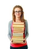 Kvinna i exponeringsglas som rymmer böcker Royaltyfri Foto