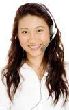 Kvinna i hörlurar med mikrofon Arkivbild