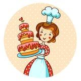 Kvinna i kök. Härlig bagare. Arkivbild