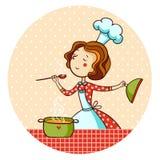 Kvinna i kök. Kock. Arkivfoto
