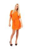 Kvinna i orange klänning Royaltyfri Foto