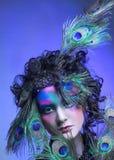 Kvinna i påfågelbild. Royaltyfri Bild