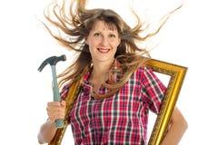 Kvinna i processen av att renovera Arkivbild