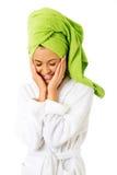 Kvinna i rörande framsida för badrock arkivfoto