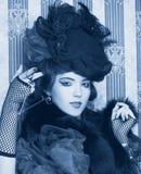 Kvinna i retro stil. Arkivbilder