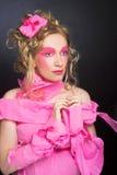 Kvinna i rosa färger. Royaltyfria Foton