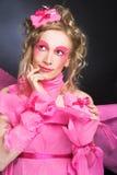 Kvinna i rosa färger. Fotografering för Bildbyråer