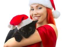 Kvinna i Santa Claus Hat med Cat Santa - gullig julkatt, Ch Royaltyfri Fotografi