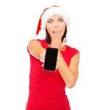 Kvinna i santa hjälpredahatt med smartphonen Arkivbilder