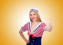 Kvinna i sjömandräkten - marin- begrepp Arkivfoto