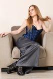 Kvinna i stolen Royaltyfria Bilder