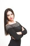 Kvinna i svart klänning Fotografering för Bildbyråer