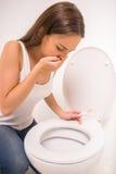 Kvinna i toalett arkivfoton