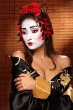 Kvinna i traditionell östlig dräkt royaltyfri foto
