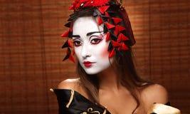 Kvinna i traditionell östlig dräkt royaltyfria bilder